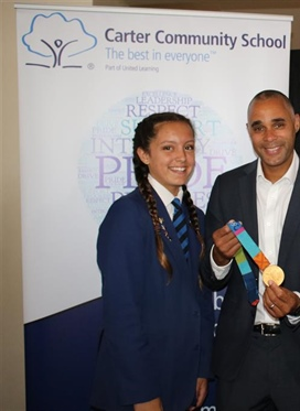 Olympic hero passes on baton of success to students at...
