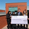 Sheffield Park Academy presents Weston Park with largest ever donation received from a school